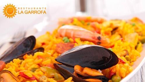 4 Tapas + 4 Bebidas o Paella + 2 Bebidas junto a la playa en Restaurante La Garrofa