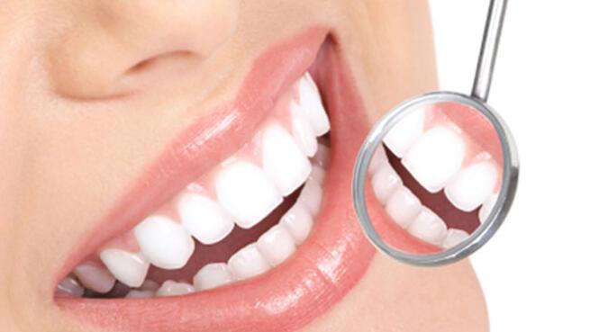 Limpieza dental con ultrasonidos + revisión bucodental